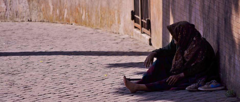 homeless-woman-sitting-on-street